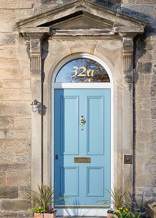 Traditional blue bespoke external door of property