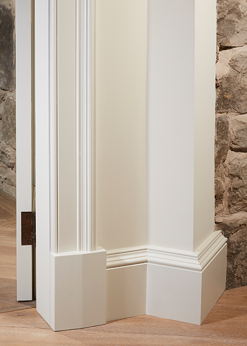 White timber skirting board on edge of door